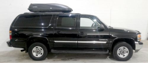 Yukon XL (4 wheel drive) SUV with trailer, and carrier